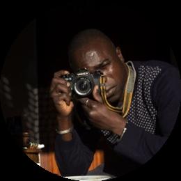 Giovane fotografo di origine Ivoriana. Abbandona il suo Paese a soli 14 anni per fuggire dalla guerra civile e approda a Roma dove scopre la vocazione per la fotografia. Le sue opere vengono oggi esposte in Italia e all'estero. Nel 2017 ha dato vita a Bamako al laboratorio fotografico KENE, uno spazio che offre una possibilità di riscatto ai ragazzi di strada.